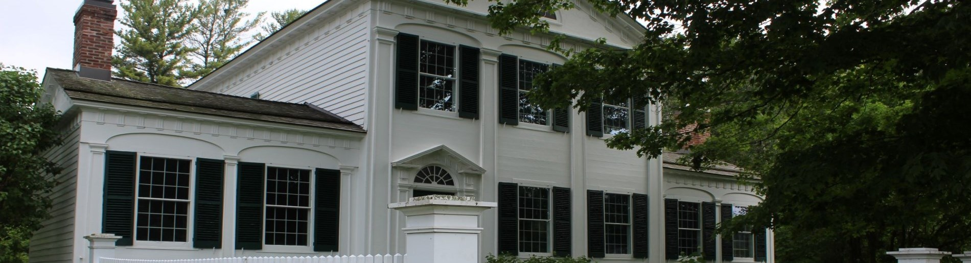white building with green doors and window shutters