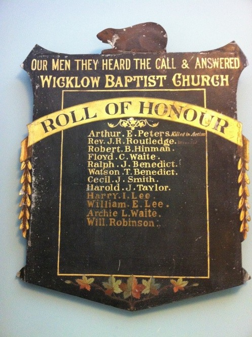 old plaque with names on it for the roll of honour