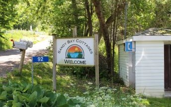 Sandy bay cottages sign