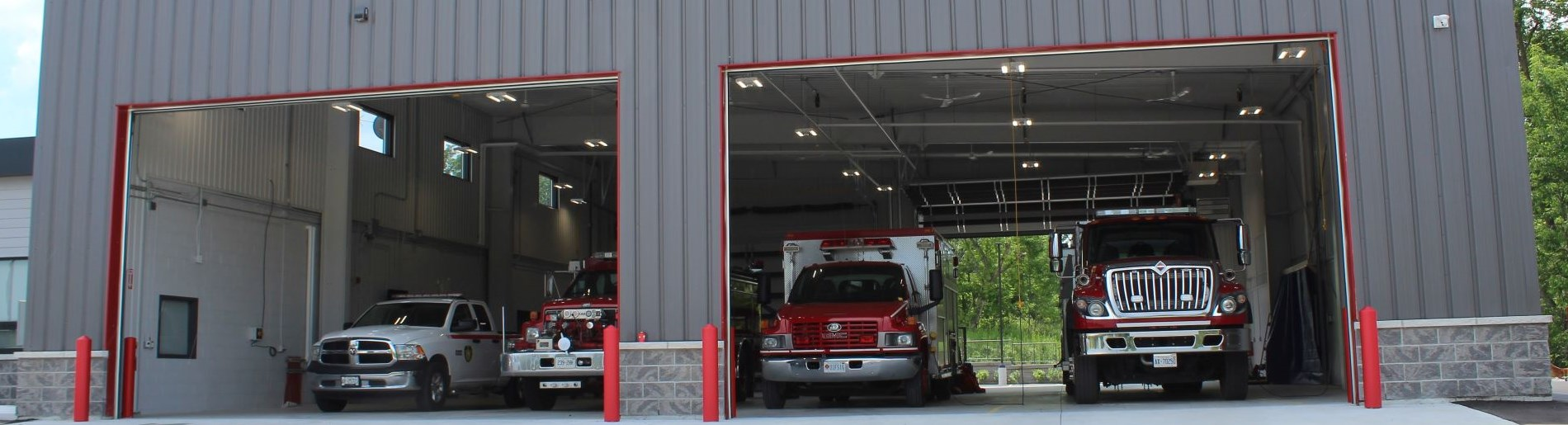 garage with fire trucks